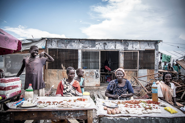 """Improvised shops like these are important sources of food. Although humanitarian agencies provide food rations, residents complain they are meagre. """"There is sorghum, but it is not enough,"""" said a 27-year old female. So some residents go to buy goods in Malakal town, and sell it in the camp"""