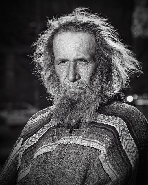 By thy long grey beard and glittering eye