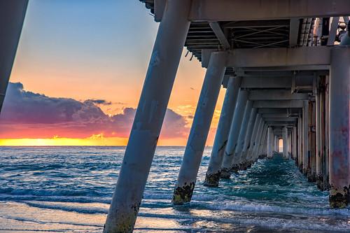 cloudsstormssunsetssunrises clouds sky sunsetsandsunrisesgold sea sunrise sun water weather pier