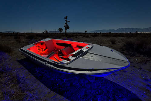 eyetwistkevinballuff eyetwist night abandoned boat speedboat beached dumped mojavedesert antelopevalley nikon nikond7000 d7000 nikkor capturenx2 1024mmf3545g 1024mm lightpainting protomachines fullmoon dark longexposure moonlight npy nocturne highdesert california mojave desert moon long exposure wideangle light painting horizon forgotten lancaster faded weathered clouds stars sky saturated av antelope valley winter startrails landscape red blue yacht waterskiing