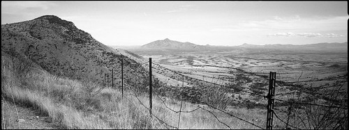 arizona blackandwhite panorama film analog america 35mm fence landscape mexico blackwhite wire unitedstates desert kodak trix border wideangle panoramic hasselblad 400 barbedwire kodaktrix analogue coronado xpan barbedwirefence desertlandscape hasselbladxpan oblong arizonadesert southernarizona mexicanborder mexicoborder coronadomemorial coronadonationalmemorial ruralarizona bwfp
