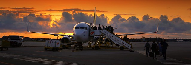 Passengers boarding in Porto at sunset