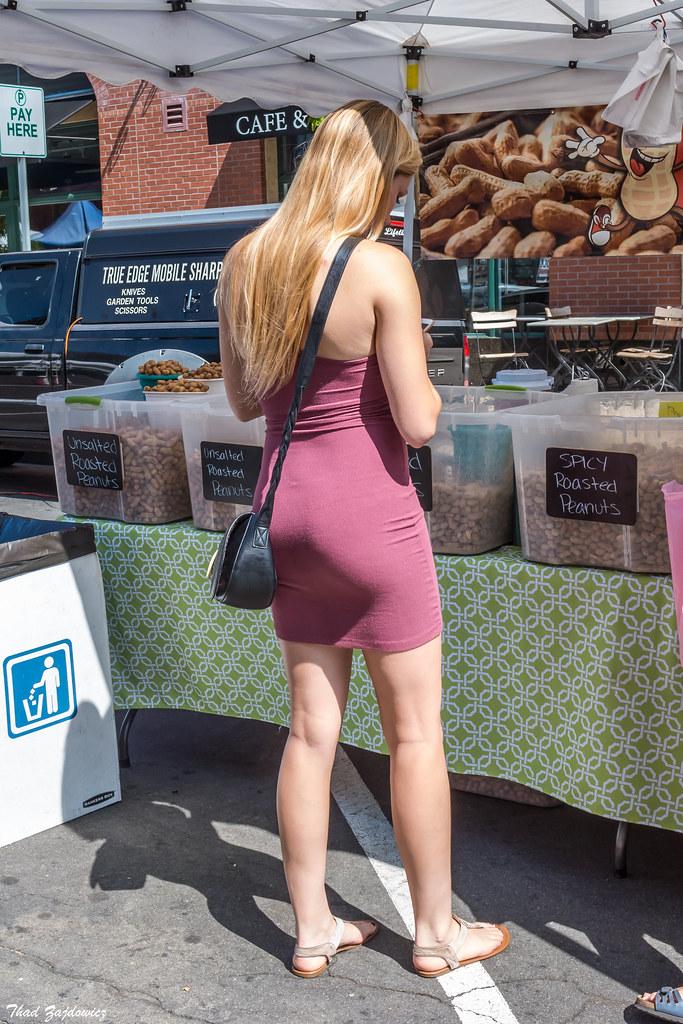 Young woman buying peanuts   Farmers Market in Pasadena, Cal
