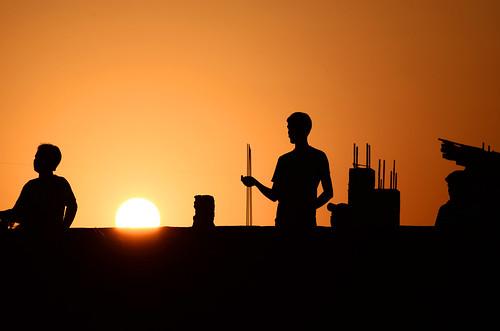 roof sunset people sun kite nikon silhouettes
