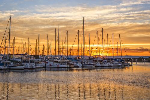 sunset sea sky water clouds boats waterreflections sunsetsandsunrisesgold cloudsstormssunsetssunrises
