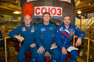 Expedition 43 NASA Astronaut Scott Kelly, left, and Russian Cosmonauts Gennady Padalka, center, and Mikhail Kornienko of the Russian Federal Space Agency (Roscosmos) take a moment during their Soyuz TMA-16M spacecraft fit check to pose for a photograph, S | by NASA Johnson
