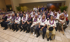 Military Intelligence Service (MIS) veterans and distinguished guests pose for a group photo before a luncheon honoring the veterans at the Hale Koa Hotel in Waikiki as part of the MIS Veterans National Reunion. (U.S. Navy/MC2 Brian Wilbur)