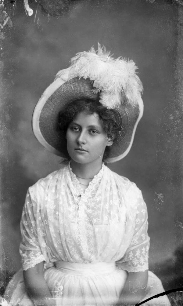 Young woman wearing a large feather hat - Tallahassee