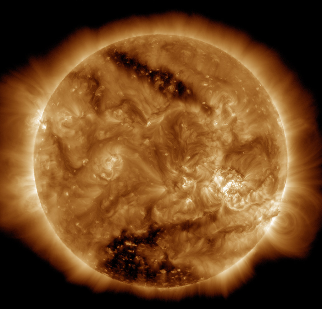 Two Coronal Holes on the Sun Viewed by SDO