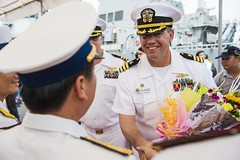 Cmdr. Christopher England, commanding officer of USS Fitzgerald (DDG 62), shakes hands with an officer from the Vietnam People's Navy during the opening ceremony of Naval Engagement Activity (NEA) Vietnam. (U.S. Navy/MCSN Patrick Dionne)