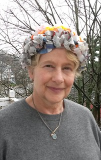 Jill in second compostable hat made from crocheted newspaper and repurposed crepe paper.