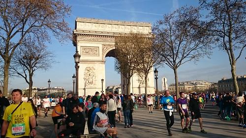 Marathoners at Arc de Triomphe   by RachelC