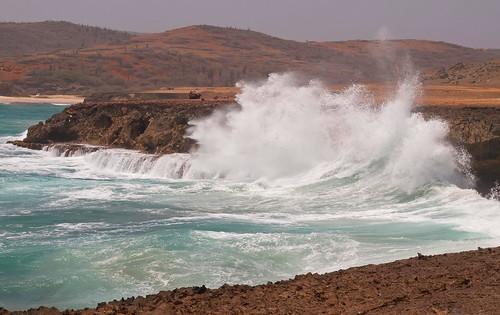 ocean sea water power desert crash wave spray shore windswept splash barren carribbean
