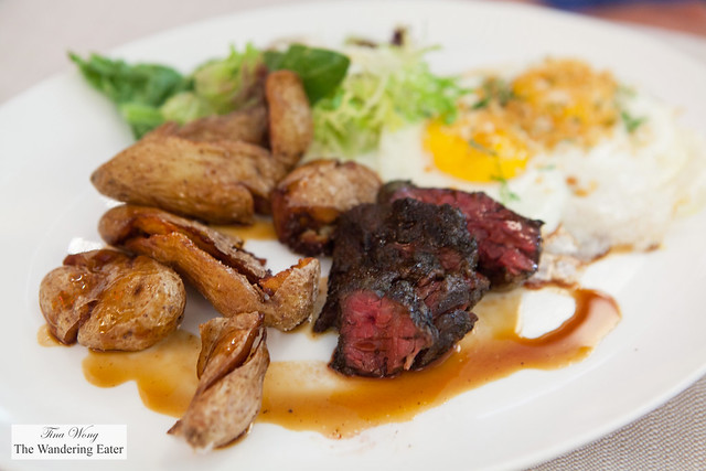 Grilled hanger steak, pan fried egg, pecorino potatoes, red wine sugo