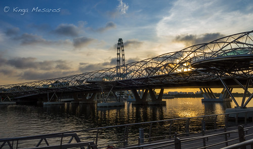 singapore cityscape bridge helix sunrise marinabay canon outdoor waterfront clouds sun ray yellow morning city