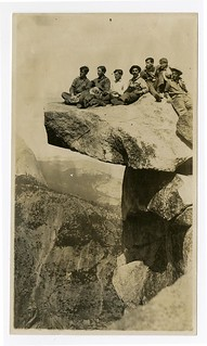 [Group of men sitting atop Overhanging Rock, Glacier Point, Yosemite] | by California Historical Society Digital Collection