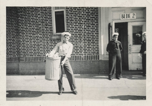 Man carrying a trash can | by simpleinsomnia