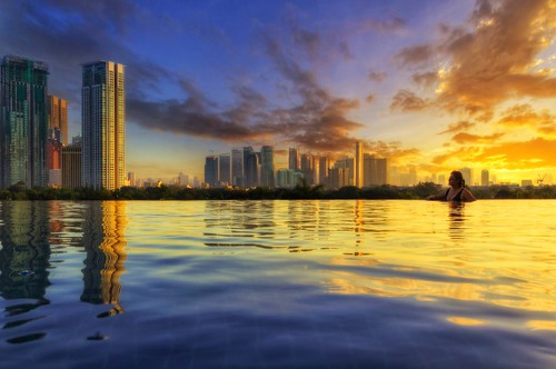 amazingsunrise cityscape itsmorefuninthephilippines philippines swimingpool waterreflections beautifulsky ayalacenter discoveryprimea infinitypool bikini sexy resort pinas vacation hotels beautifulhotels travelphotos asia