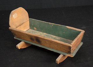 Repaired doll cradle