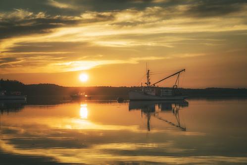 lubecsunset maine newengland boat coastalmaine coastalnewengland fishingvillage lobster lobsterboat oceanside reflections roadtrip seascape seaside seasidesunset sunset lubec unitedstates us