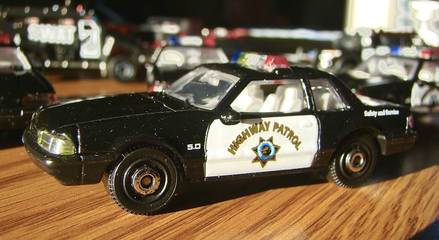 Match Box Highway Patrol vehicles.