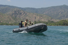 In this file photo, Machinist's Mate 2nd Class Alexander Arellanokendall and members of the Timor-Leste Defense Force test the sea worthiness of a rigid-hull inflatable boat (RHIB) after repairs were made to it during CARAT 2016. (U.S. Navy/MCC Lowell Whitman)