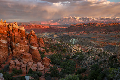 fiery furnace lasal mountains mountain landscape sky clouds canyon cloudy spires rock formation orange magenta moab utah sunset moody