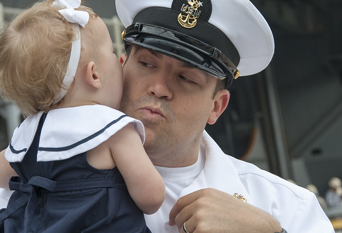 A Sailor says goodbye to his daughter as the USS George Washington prepares to depart. | by Official U.S. Navy Imagery