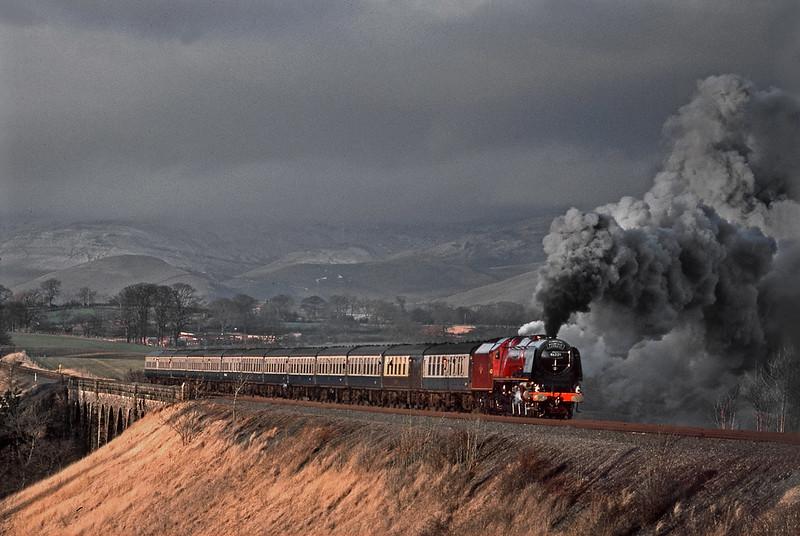 46229 Duchess of Hamilton has just crossed Ormside Viaduct. 7 January 1984.