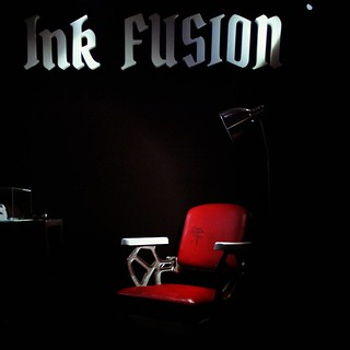 Ink Fusion + red chair  #Tatooconvention #Red #Tatoo #Black #Light #Milano #Chair. #igersmilano | by Mario De Carli