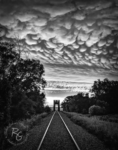 traintracks trainbridge hawarden iowa siouxcounty bigsiouxrivercrossing bigsiouxriver hawardenia intothesunset sunset stormclouds summerstorm northernexposure julystorm 1635mmf28lii northwestiowa mammatusclouds