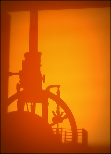 metal steam engine flywheel abstract machine