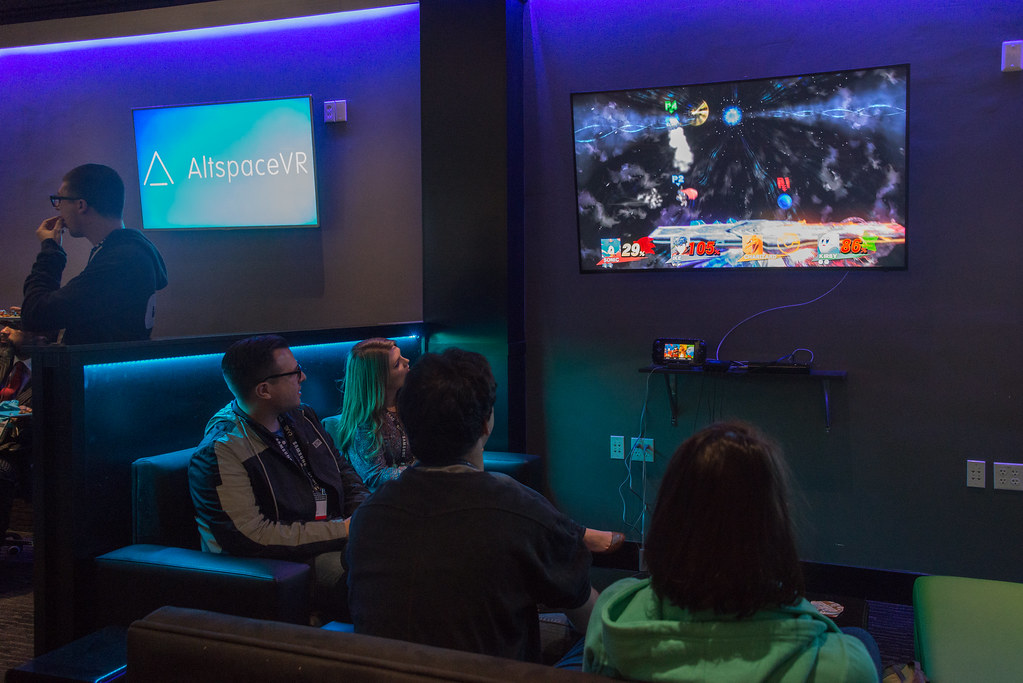 SVVR attendees playing Smash Bros at AFK Gamer Lounger afterparty