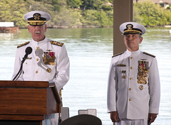 Adm. Scott H. Swift reads his orders as he assumes command of U.S. Pacific Fleet from Adm. Harry B. Harris Jr. on Wednesday. (U.S. Navy/MC2 Diana Quinlan)