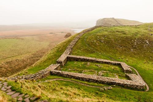 milecastle roman hadrianswall northumberland nationalpark heritage ruins whinsill archaeology landscape craglough lake hillfarming hill crag mist