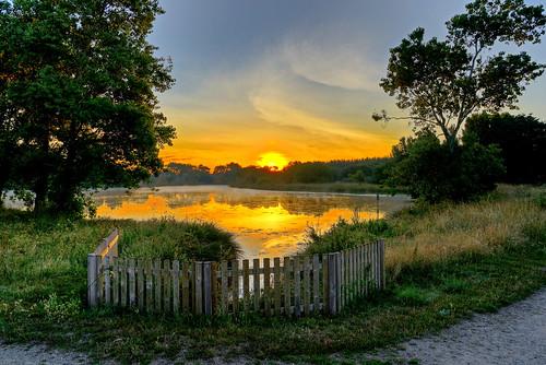 lake france reflection sunrise fence lac loch damgan