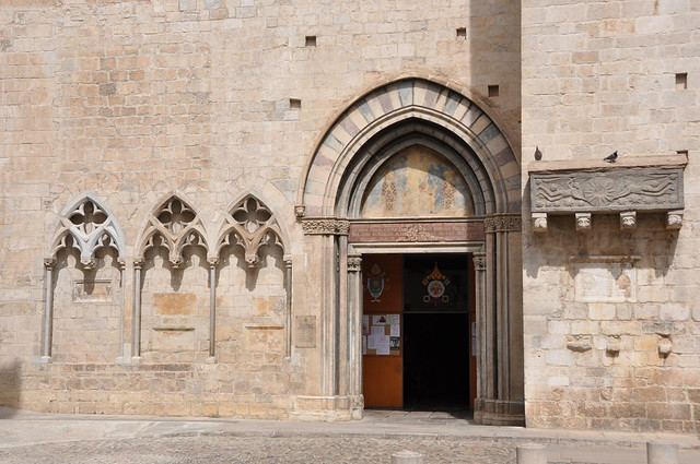 Girona. Collegiate church of St Feliu. Southern portal and tombs. 14th. C.
