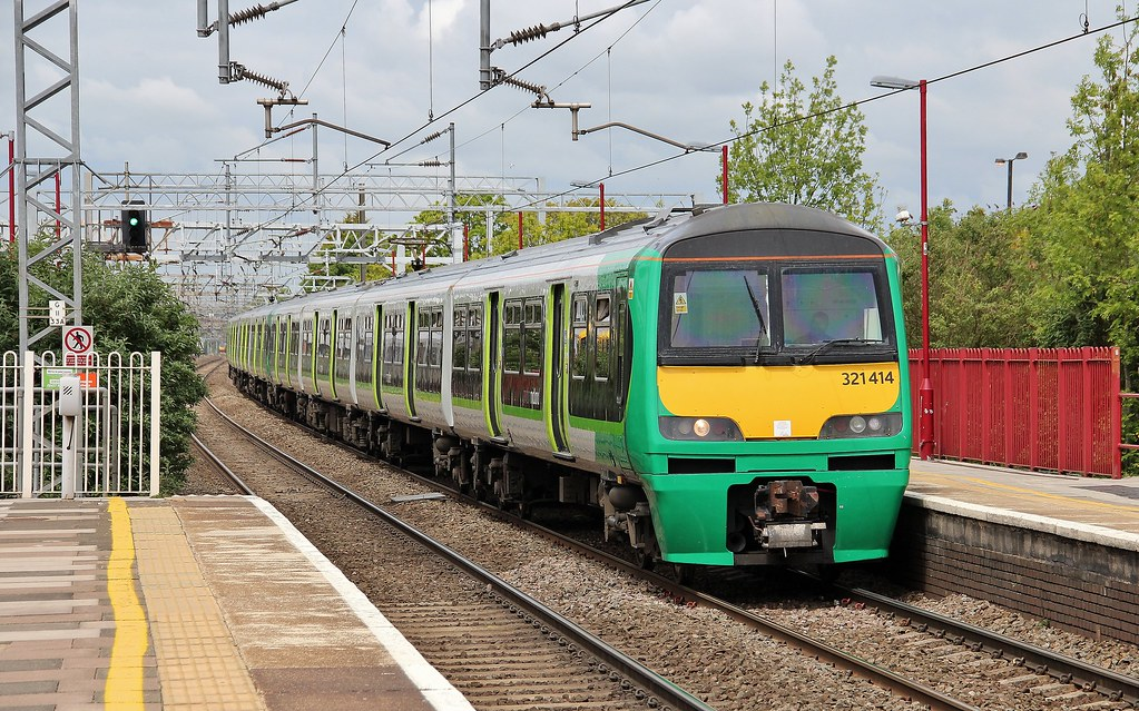 London Midland Trains service comprising 321414 + 321411, arriving at Harrow & Wealdstone Station, 20th. May 2015. by Crewcastrian