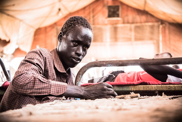 A man takes a moment to reflect as he repairs his bed. After over two years spent in displacement camps, and still no signs of peace, people like him now have only two options: stay put or leave the country altogether, both of which carry risks. U.N. bases have not been immune from attacks. The protection site in Malakal was overrun by armed elements in February, killing at least 25 people, and its base in Juba was caught-up in the cross-fire in the recent violence in the capital. Meanwhile, choosing to be a refugee comes with its own pile of vulnerabilities.