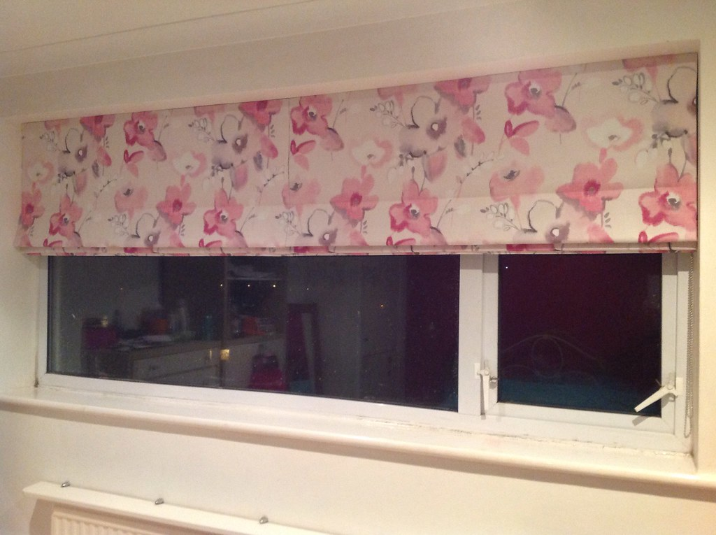 Roman blinds.