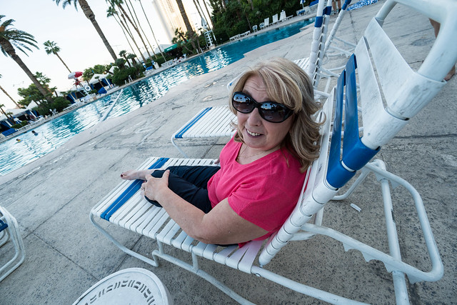 Mom relaxes in a pool chair at Bally's