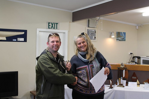 Chris Knight, winner of the B Fleet Club Champs being presented the Peterson Trophy by Chantal Grass | by PLSC (Panmure Lagoon Sailing Club)