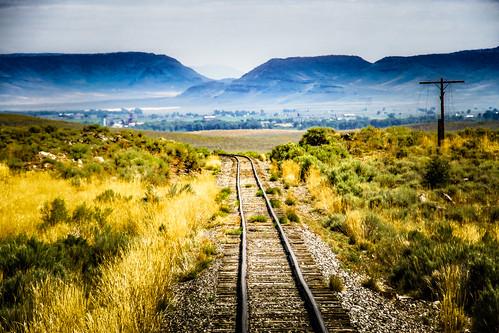 mountainside morning landscape traintracks utilitypole tracks railway daytime outdoors cumbrestoltec mountain antonito colorado unitedstates us