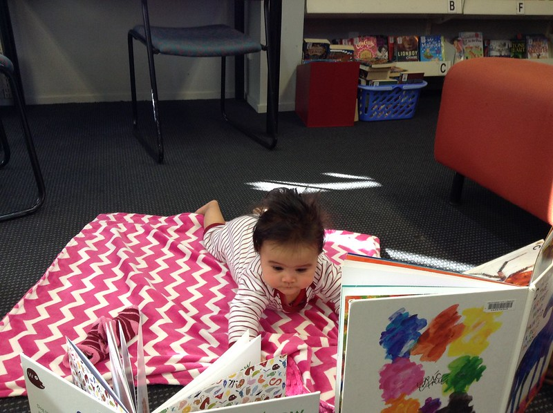Maya enjoys reading books at Halswell Library