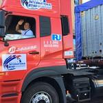 Caravan_pilot_inner Mongolia_red truck_waving