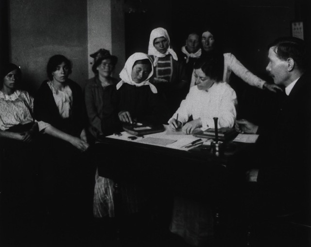 A female immigrant piecing together a wooden puzzle as part of an examination