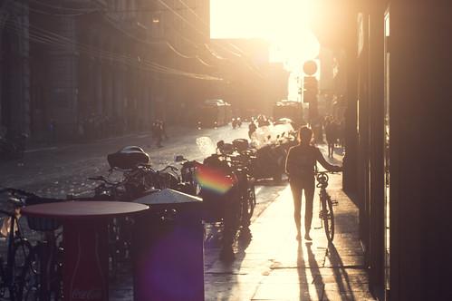street city light sunset people urban italy abstract wet water rain bike bicycle drops focus warm italia walk live transport bologna raid tones tone
