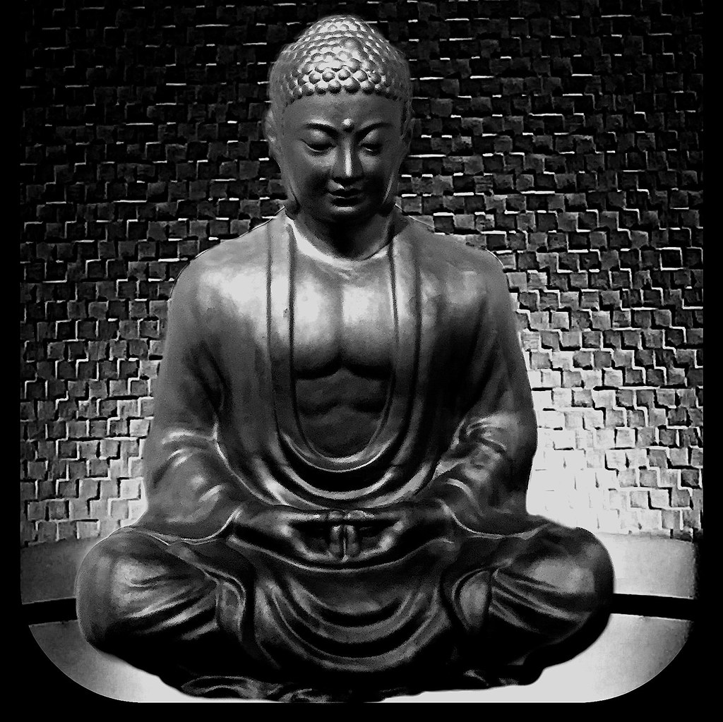 A buddha statue in black and white by buddhadog