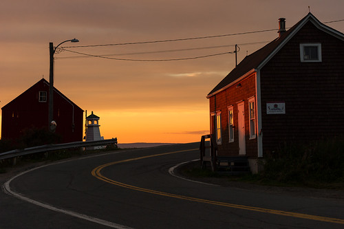 hallsharbour novascotia canada mauricewoodworth parkers general store sunset kingscounty bayoffundy atlantic pastel colours clouds curve road lighthouse village fishing backlit