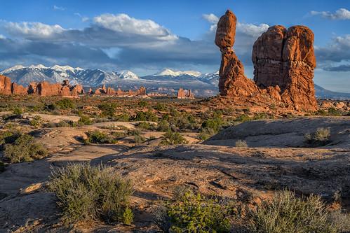 balancedrock sunset lasalmountains snowonmountains archesnationalpark moab utah arches sandstone desert scenery landscape